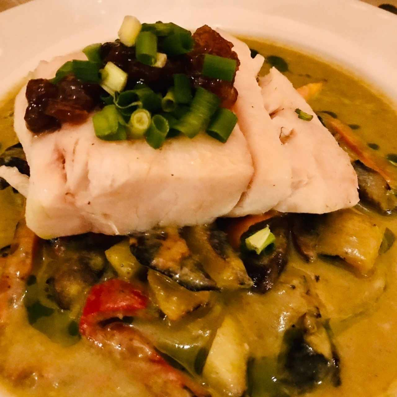 Fish of the day with green pineapple curry sauce