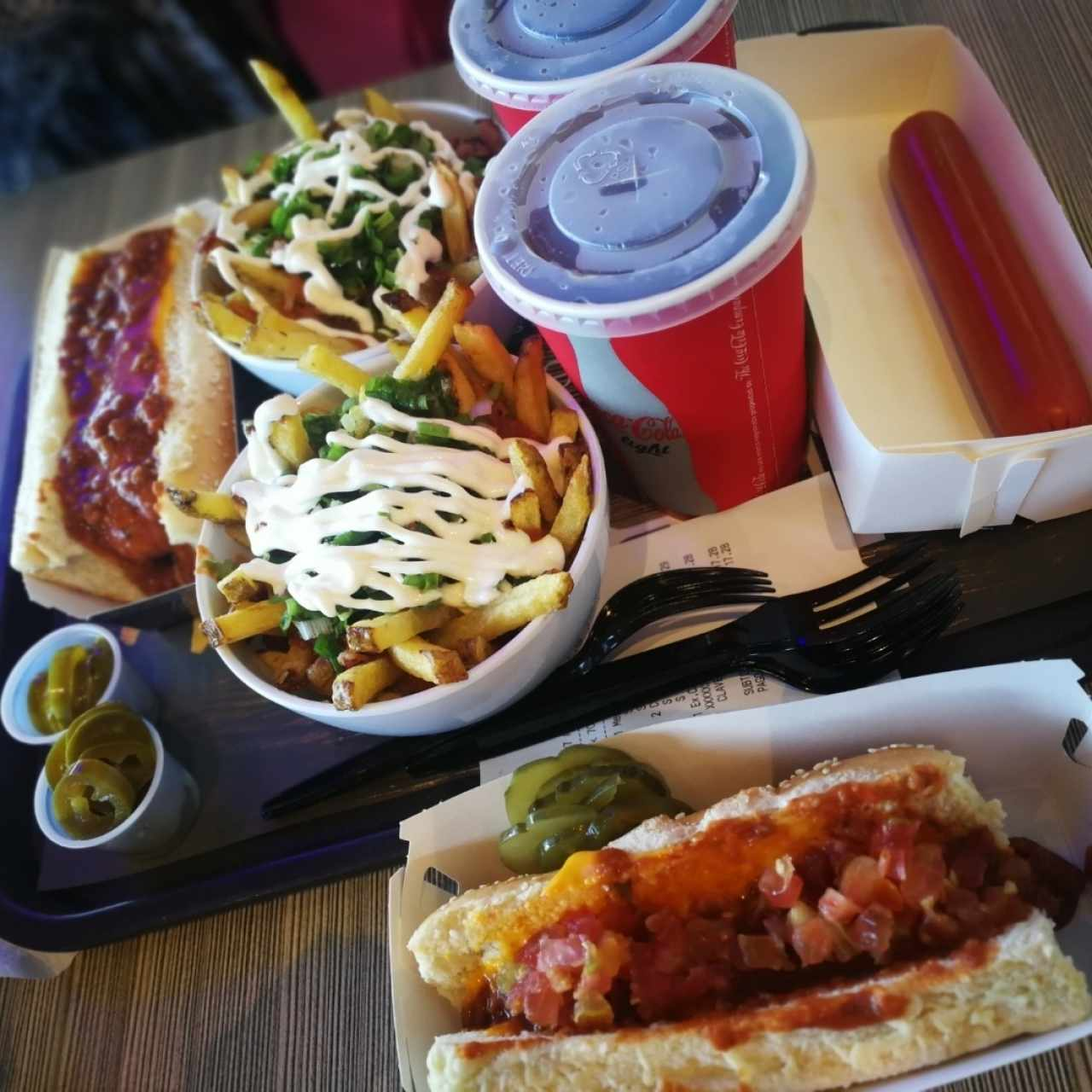 wok fries, chilli dog, sausage in the side and coke