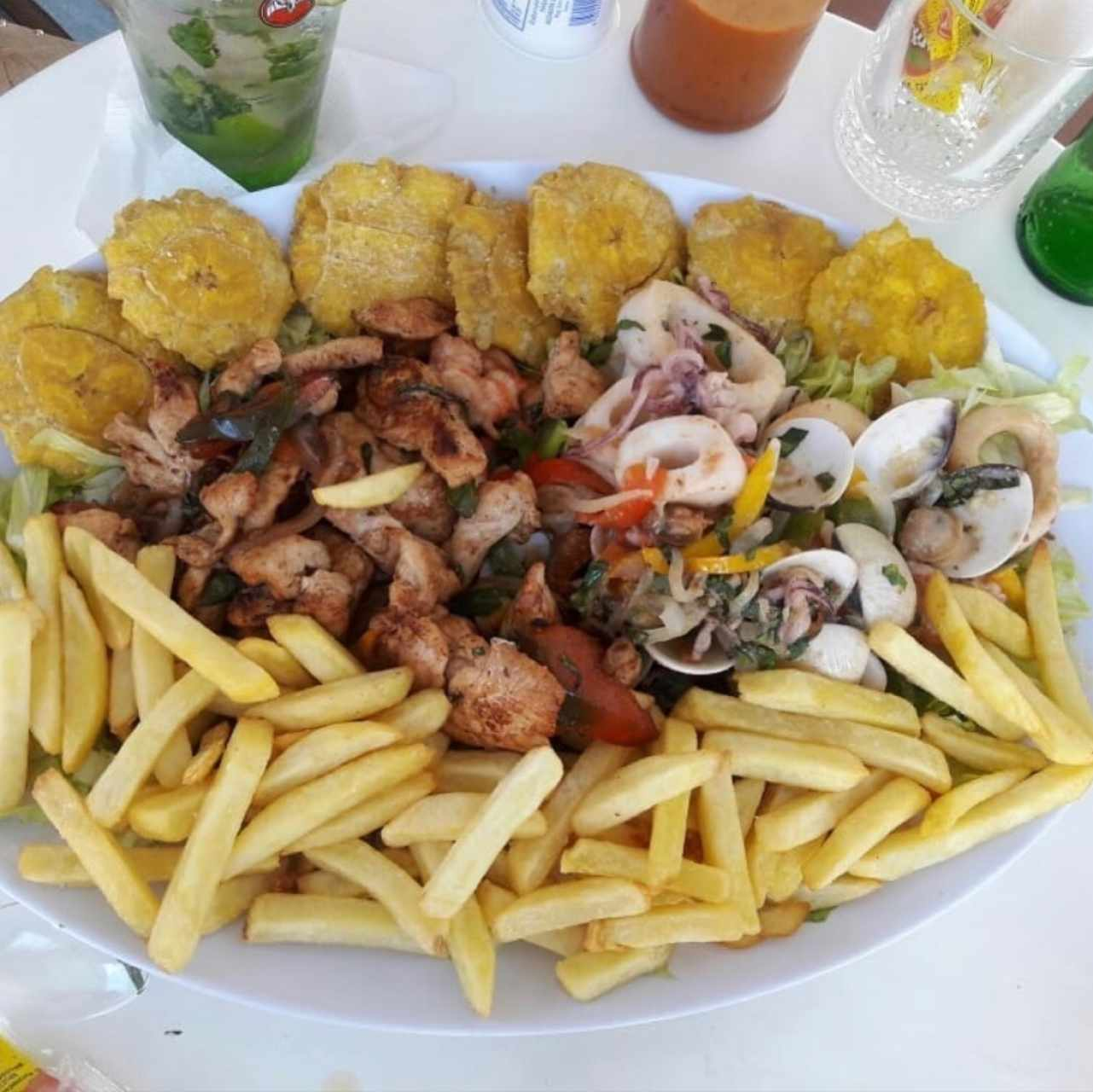 Ceviche (fresh and fried) with patacones and fries