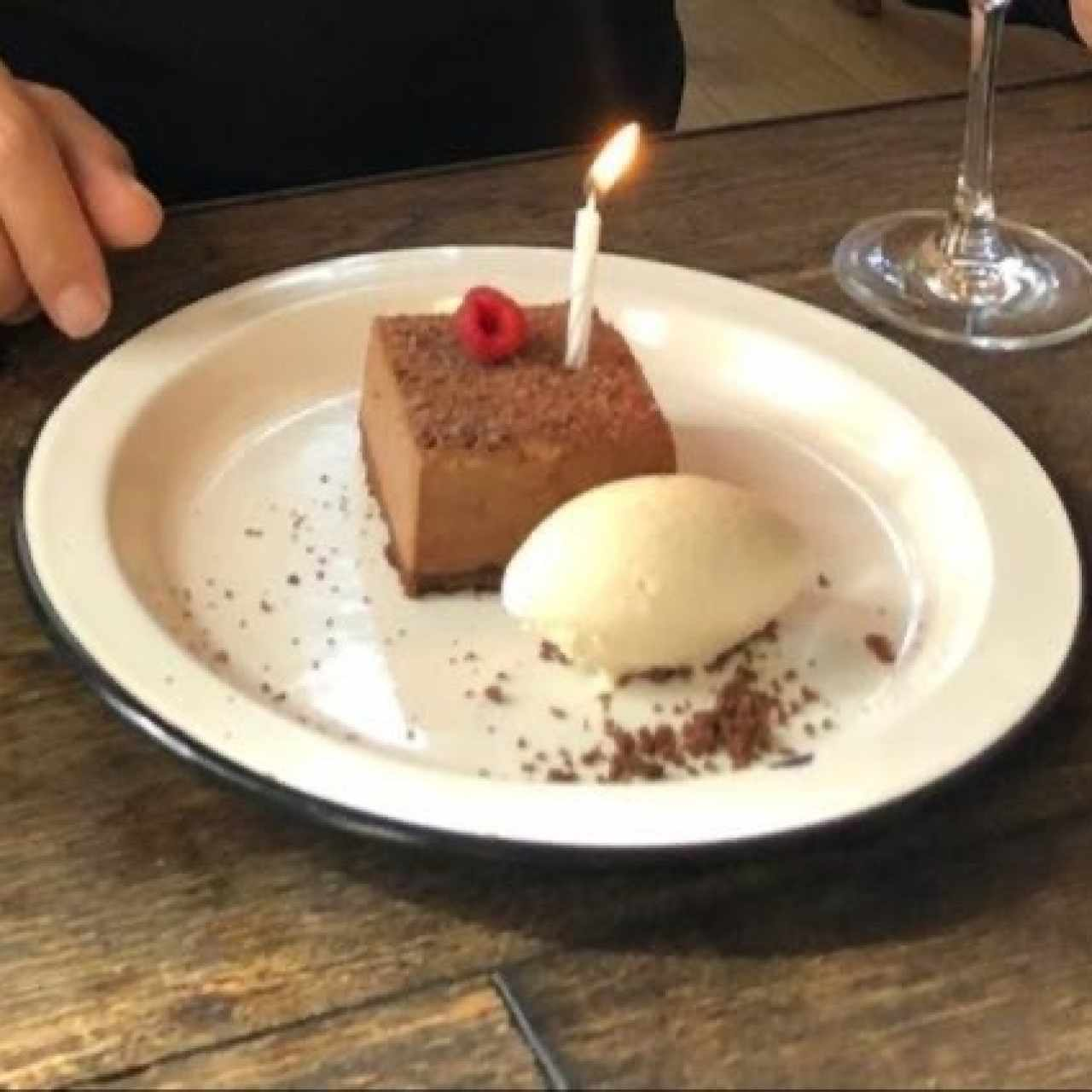 chocolate mousse birthday cake on the house