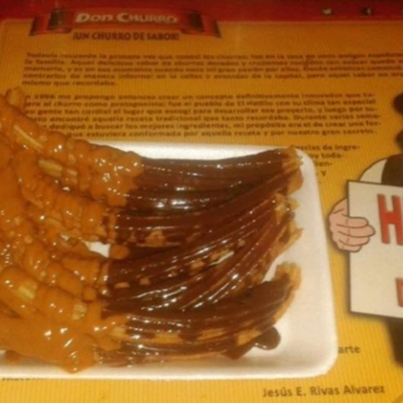 Churros con arequipe y chocolate